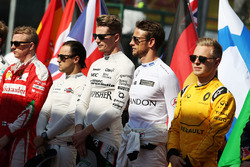 Nico Hulkenberg, Sahara Force India F1 and Jenson Button, McLaren as the grid observes the national anthem