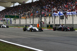 Jenson Button, McLaren MP4-31 and Felipe Massa, Williams FW38 battle for position