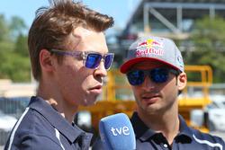 (L to R): Daniil Kvyat, Scuderia Toro Rosso with team mate Carlos Sainz Jr., Scuderia Toro Rosso