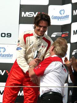 Third place finisher Milos Pavlovic celebrates on the podium with Jonathan Palmer Motorsport Vision Chief Executive