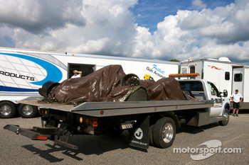 The wrecked #9 Patron Highcroft Racing Acura ARX-02a Acura is brought back to the paddock