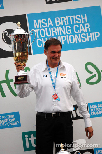 Dick Bennett, head of WSR, receives trophy on behalf of Colin Turkington