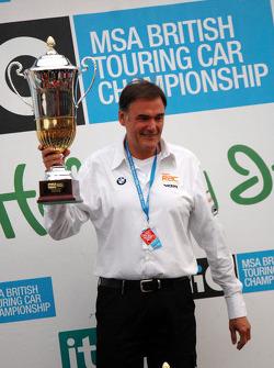 Dick Bennett, head of WSR, receives trophy on behalf of Colin Turkington