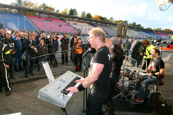 A band playing in front of the Abt Audi pitbox to celebrate the 2009 DTM championship
