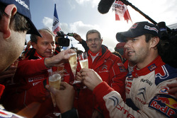 Winners and 2009 WRC champions Sébastien Loeb and Daniel Elena celebrate