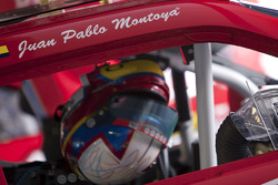 Juan Pablo Montoya's helmet hangs in his car before practice