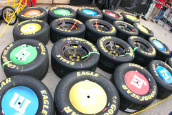 Tires for Kyle Busch sit like M&M's candy on the pit lane