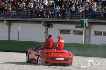 Luca di Montezemolo drives Felipe Massa and Fernando Alonso around the track in a Ferrari California: oops, stuck in the gravel