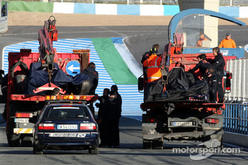The cars of Brendon Hartley, Tests for Scuderia Toro Rosso and Daniel Ricciardo, Tests for Red Bull Racing are returned to the pits after the both stopped on track