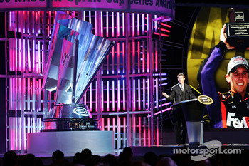 Denny Hamlin accepts his award for fifth place in the Chase for the NASCAR Sprint Cup