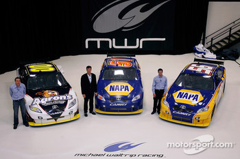 Michael Waltrip Racing's NASCAR Sprint Cup Series drivers David Reutimann, Michael Waltrip and Martin Truex Jr. pose with their rides