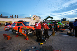 Earnhardt Ganassi Racing Chevrolet crew members work on the wrecked car of Jamie McMurray