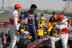 Jenson Button, McLaren Mercedes with Mark Webber, Red Bull Racing and Lewis Hamilton, McLaren Mercedes