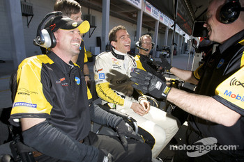 Oliver Gavin shares a laugh with Corvette Racing team members