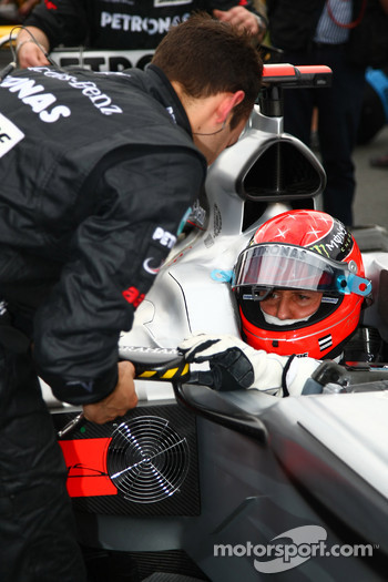Michael Schumacher, Mercedes GP adjusts his mirror