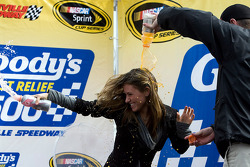 Victory lane: Denny Hamlin's girlfriend, is covered with gatorade