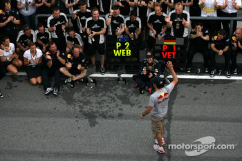 Race winner Sebastian Vettel, Red Bull Racing celebrates with Mark Webber, Red Bull Racing, and his team