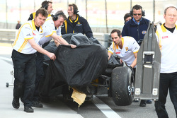 The car of Vitaly Petrov, Renault F1 Team is pushed back to the pits