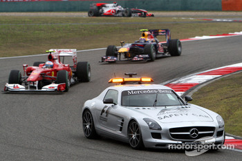 The safety car leads Fernando Alonso, Scuderia Ferrari