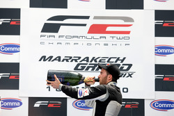 Race winner Philipp Eng celebrates with the Champagne on the podium