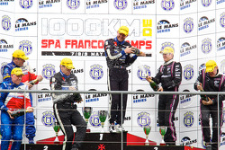 LMP2 podium: class winners Miguel Amaral and Olivier Pla, second place Thomas Erdos, Mike Newton and Andy Wallace, third place Richard Hein and Guillaume Moreau celebrate with champagne