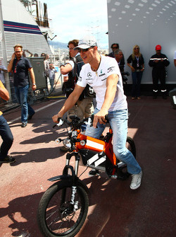 Michael Schumacher, Mercedes GP Petronas on a bike in the paddock