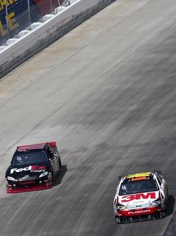 Denny Hamlin, Joe Gibbs Racing Toyota and Greg Biffle, Roush Fenway Racing Ford