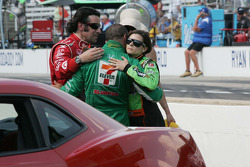 Race winner Dario Franchitti gets a hug from Tony Kanaan and Danica Patrick