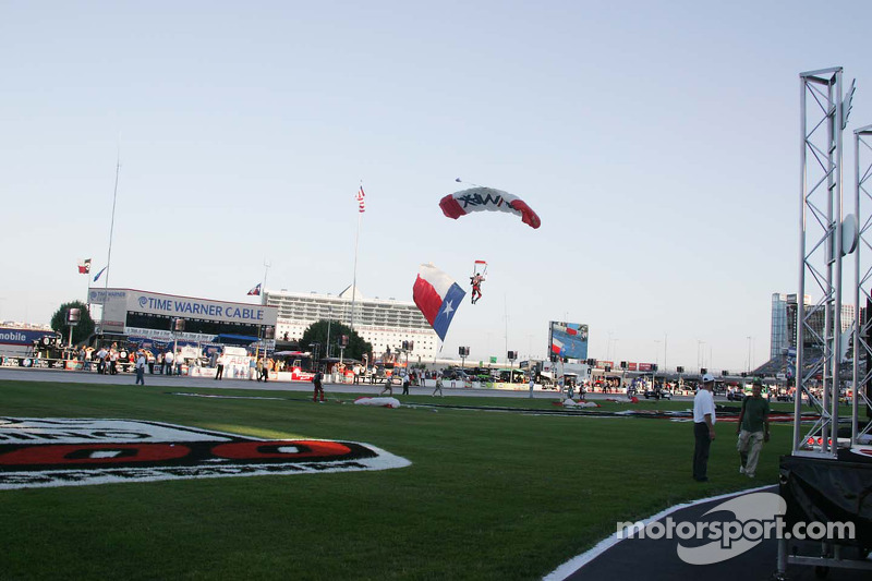 The Texas flag arrives during pre-race ceremonies