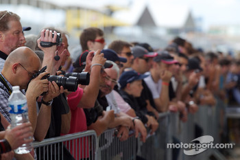 Fans take pictures at pitwalk