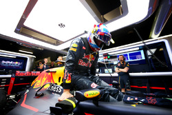 Max Verstappen, Red Bull Racing gets into his car in the garage