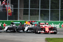 Sebastian Vettel, Ferrari SF16-H leads Lewis Hamilton, Mercedes AMG F1 W07 Hybrid and Nico Rosberg, Mercedes AMG F1 W07 Hybrid at the start of the race