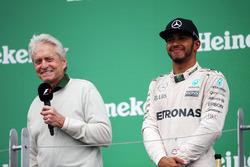 (L to R): Michael Douglas, Actor on the podium with race winner Lewis Hamilton, Mercedes AMG F1