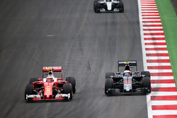 Kimi Raikkonen, Ferrari SF16-H and Jenson Button, McLaren MP4-31