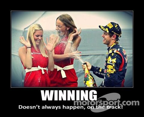 Vettel Spraying the Podium Girls