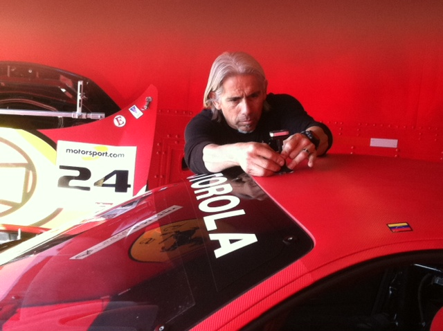 The Auto Gallery Motorsports Competition Director, Rudy Courtade adjusts the camera.