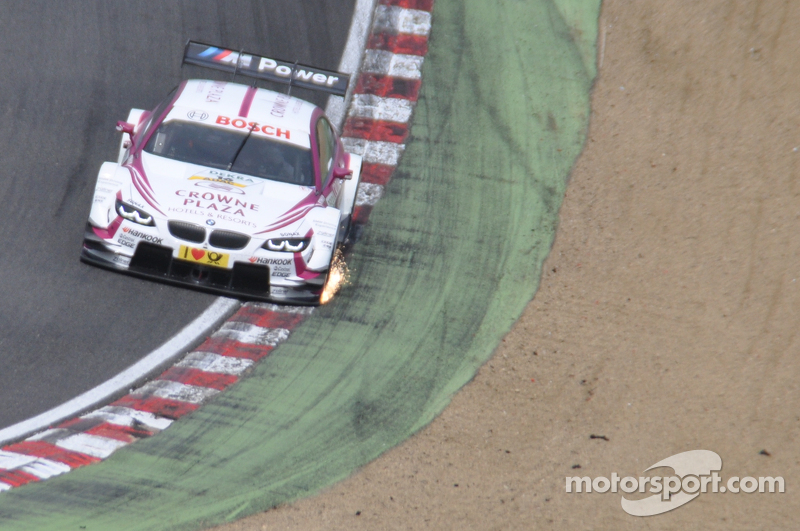 Andy Priaulx's splitter scrapes the curbs on Paddock Hill bend
