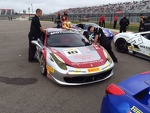 Auto Gallery Motorsports technicians Don and Dave Cameron tend to Jim Weiland's  458 Italia