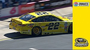 Logano blows a tire, hits the wall