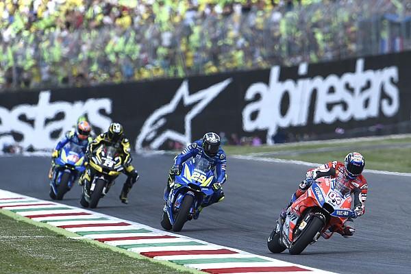 "MotoGP Marquez crash like ""gold"" for Dovizioso title bid"