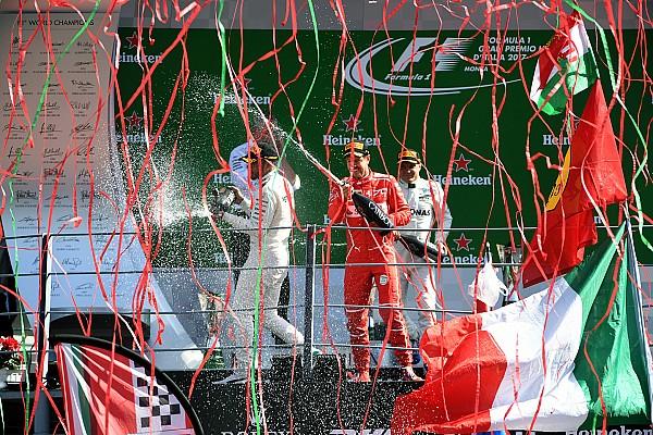 Die Geschichte zum Bild: Luftschlangen auf dem F1-Podium in Monza