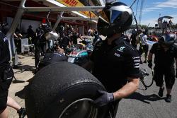 A Mercedes pit crew member, a wheel