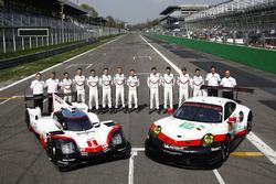 Porsche Team members with the Porsche 919 Hybrid and Porsche 911 RSR