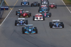 Michael Schumacher, Benetton B194 Ford leads Damon Hill and Nigel Mansell, Williams FW16B Renault