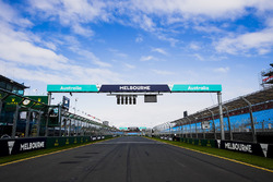 Melbourne signage along the pit straight and above the start light gantry