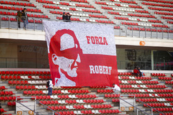 Fans tie down a flag in support of Robert Kubica, Williams FW41