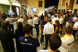 F1 personel gather in the paddock to watch the E-Sports races