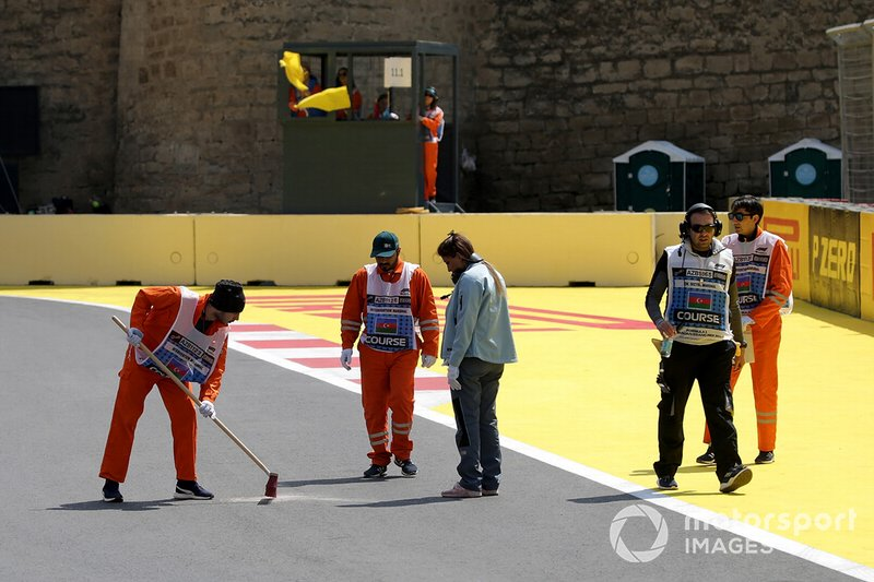 Marshals sweep the track