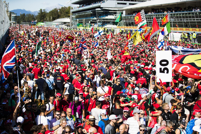 A huge sea of mainly Ferrari fans invade the circuit after the race