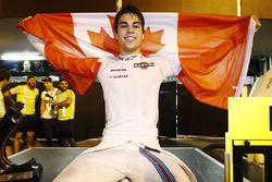 Lance Stroll, Williams FW40, celebrates third place by displaying a Canadian flag in the pit lane